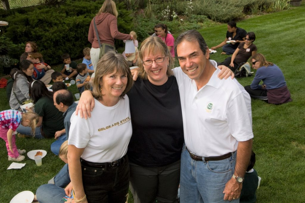 Prue Kaley (left) Lise Youngblade (middle) and Mark Goldrich (right) smiling in group photo at Kaley's garden