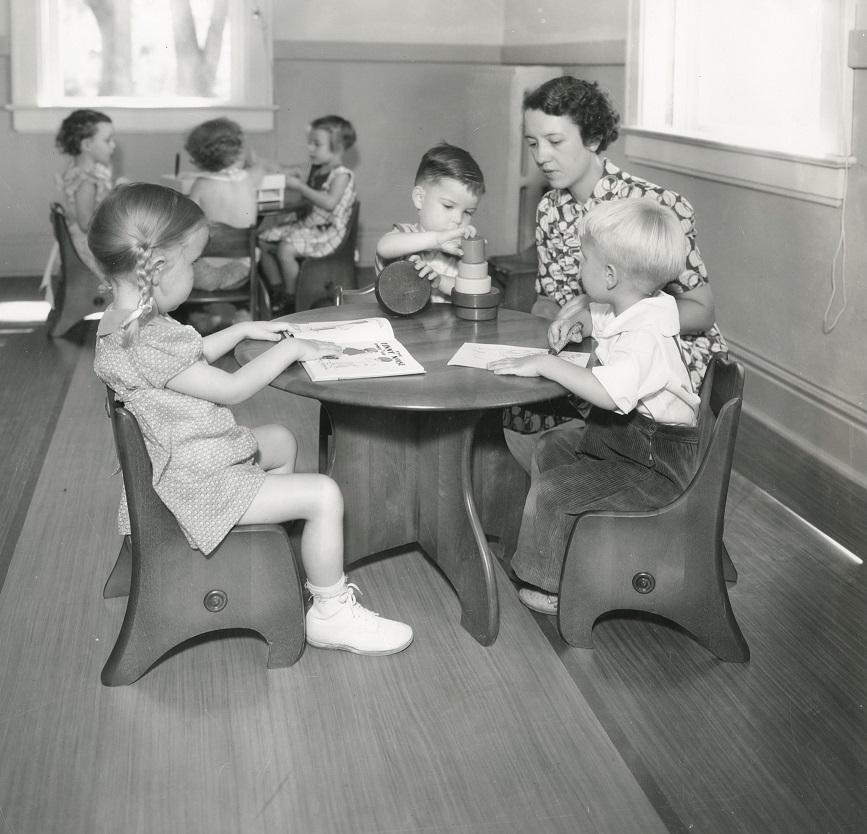 Preschool Teacher And Students On July 30, 1936
