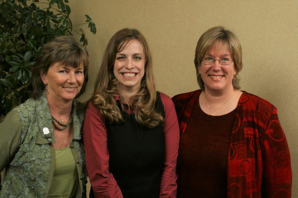 Prue Kaley (left), Scholarship recipient (middle), and Lise Youngblade (right) smiling in group photo