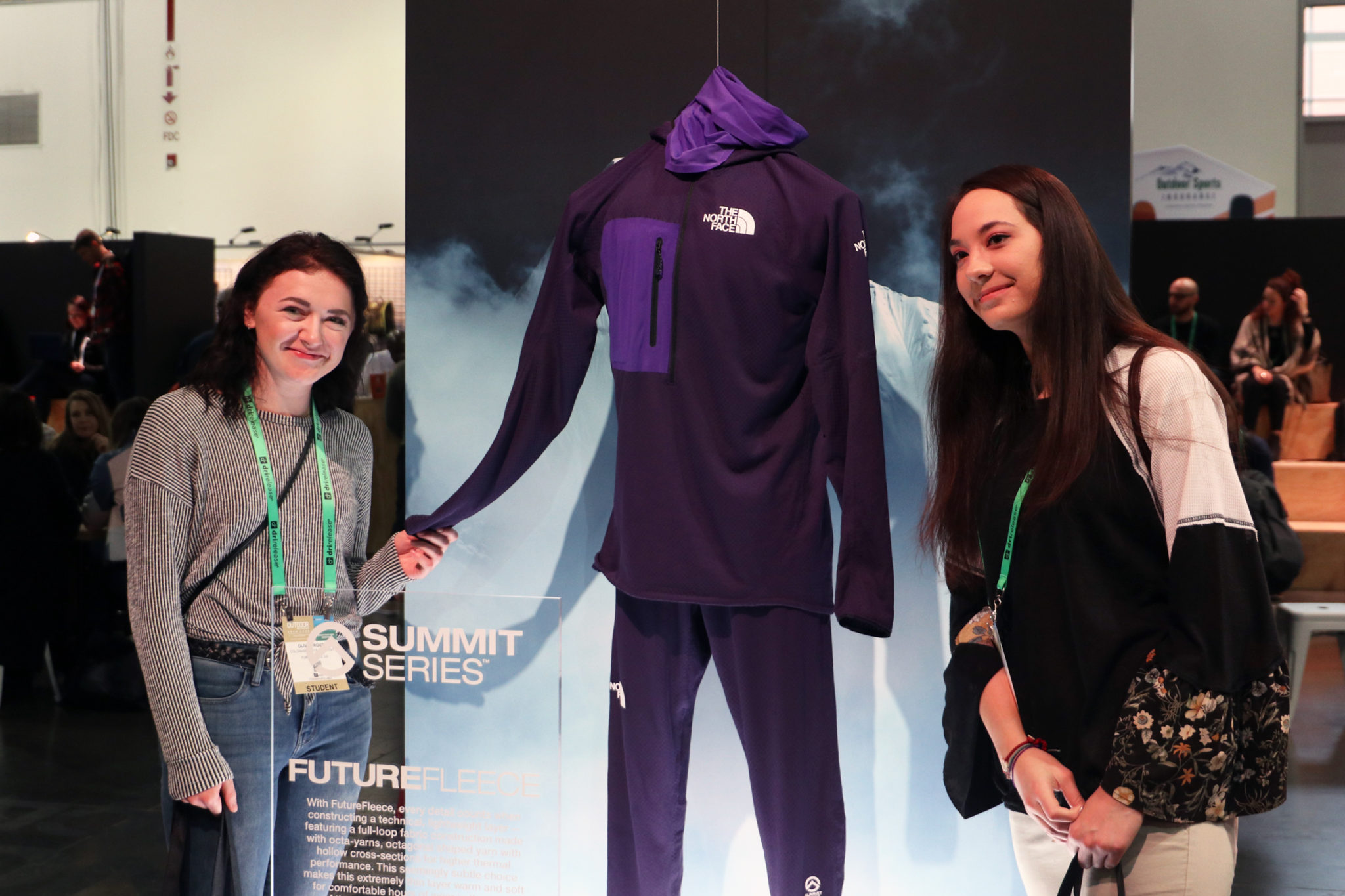 Students standing next to a display of Northface's 2020 outdoor wear.