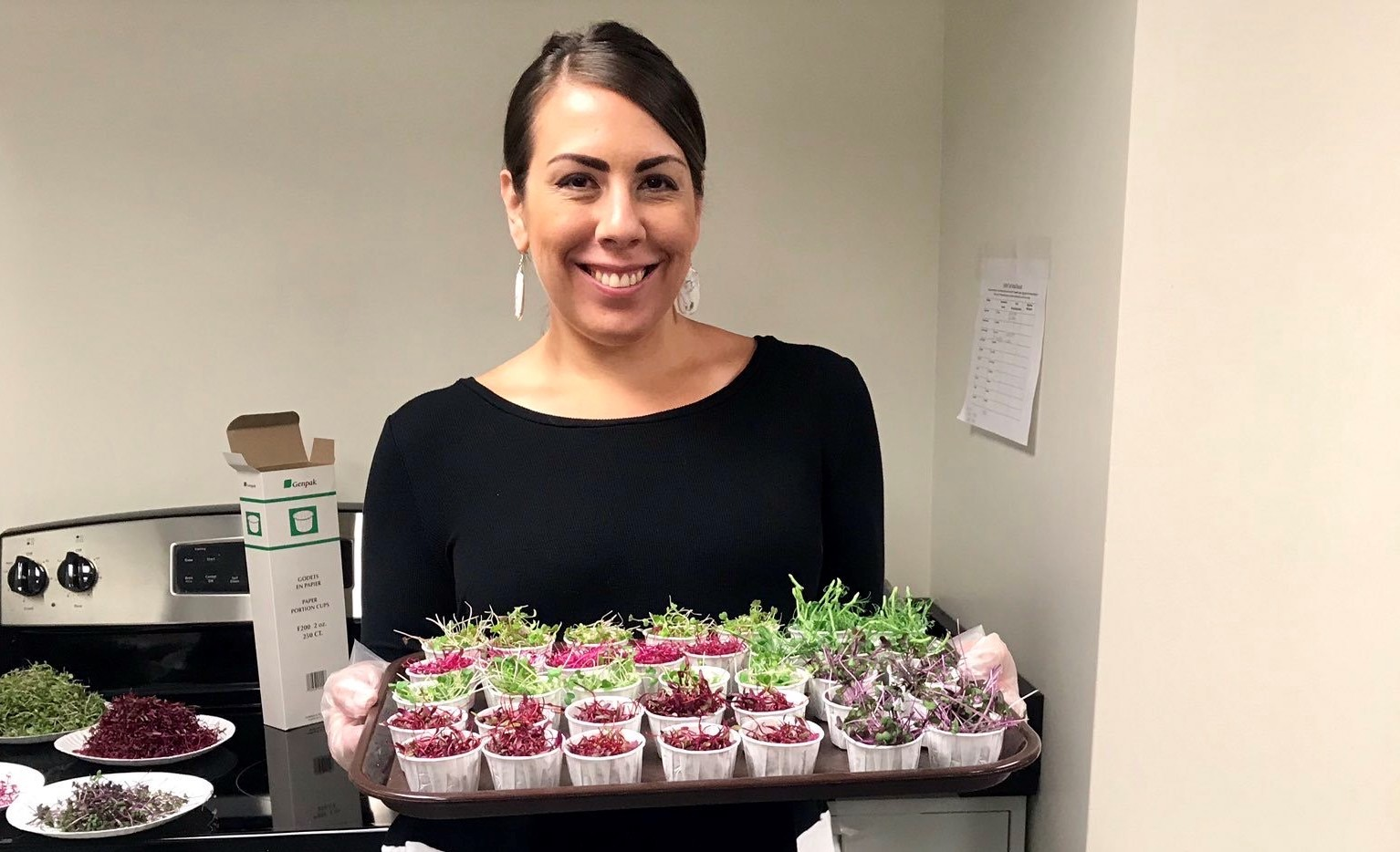 Sarah Johnson with microgreens