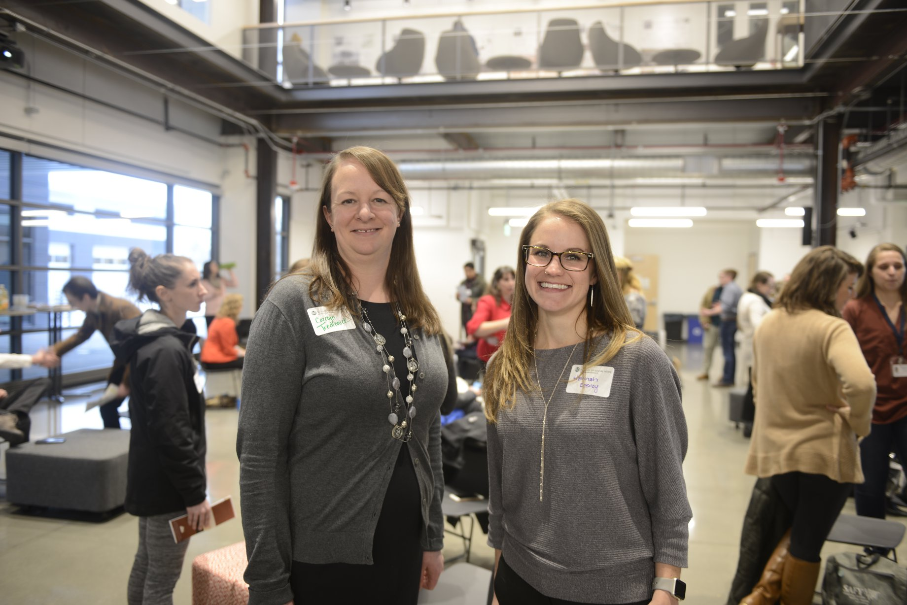 Carolyn Tredinnick And Hannah Eppley standing together at a field education event