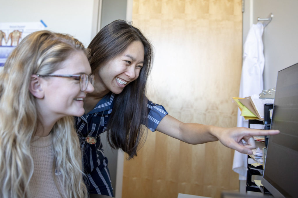 Gloria Luong works with an undergraduate student in her lab.