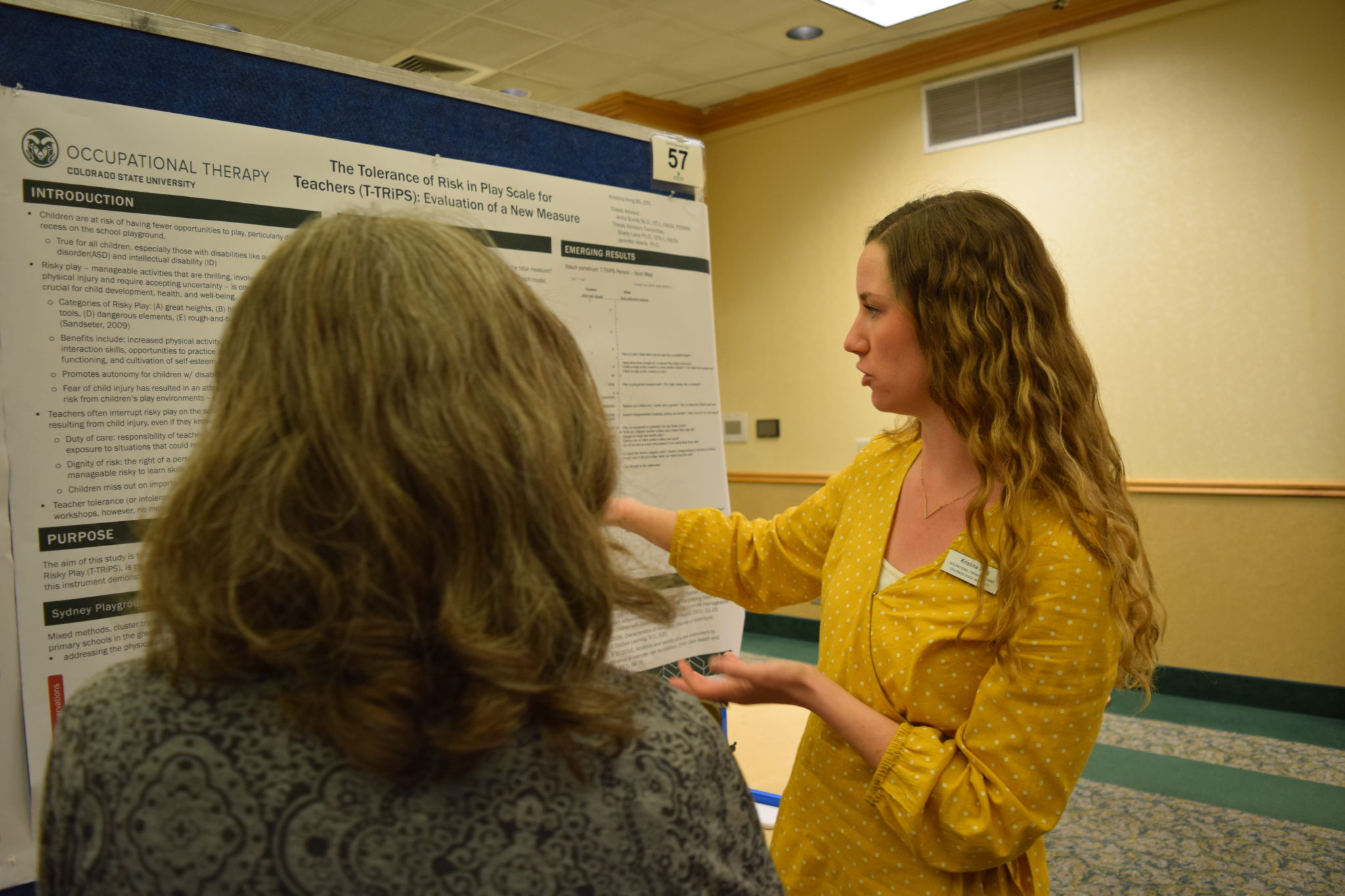 Presenter explains her poster.