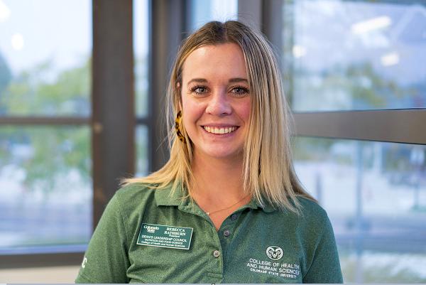 Becca Rathburn smiles in a green polo.