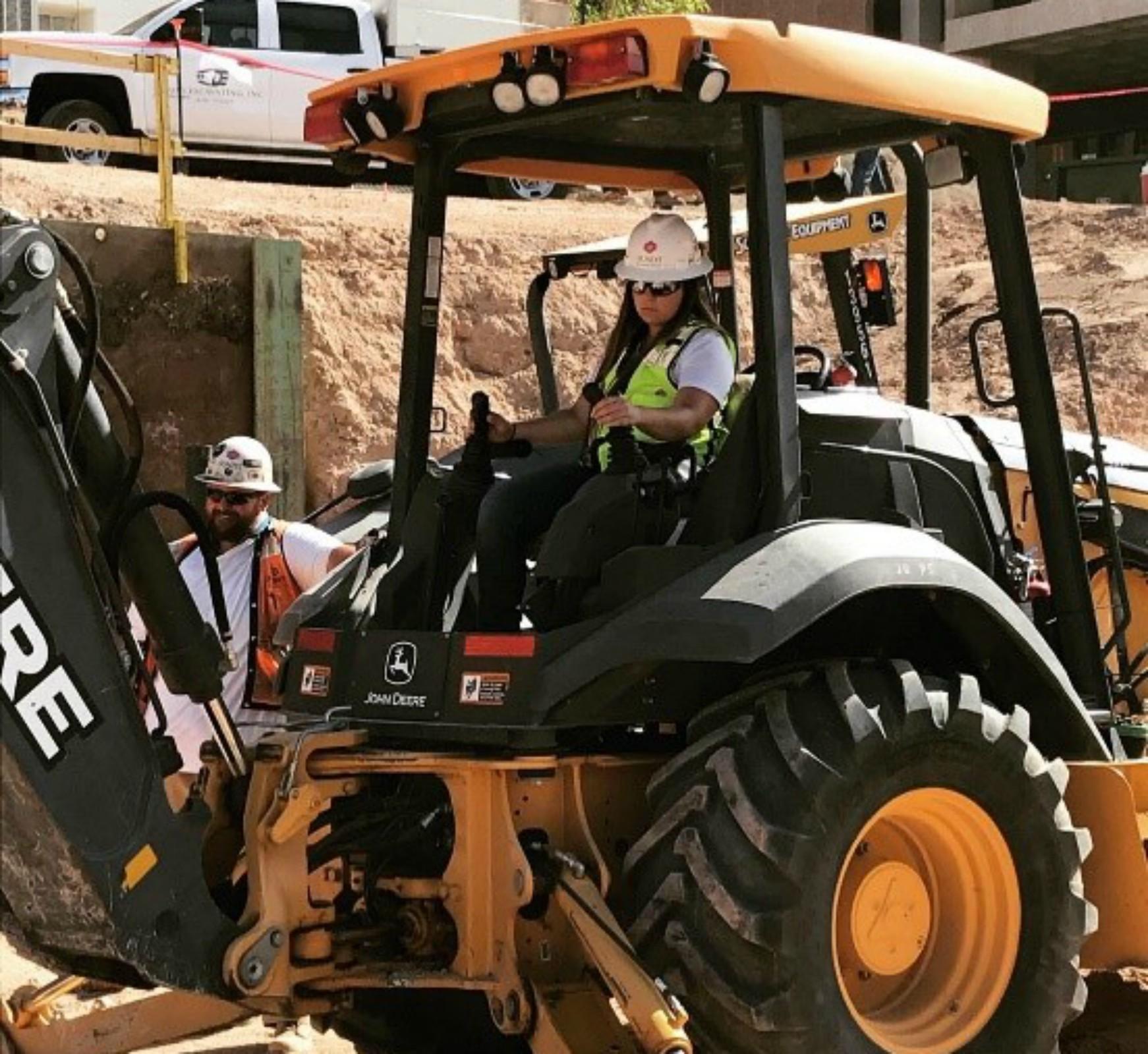 MacKenzie Brock driving heavy equipment