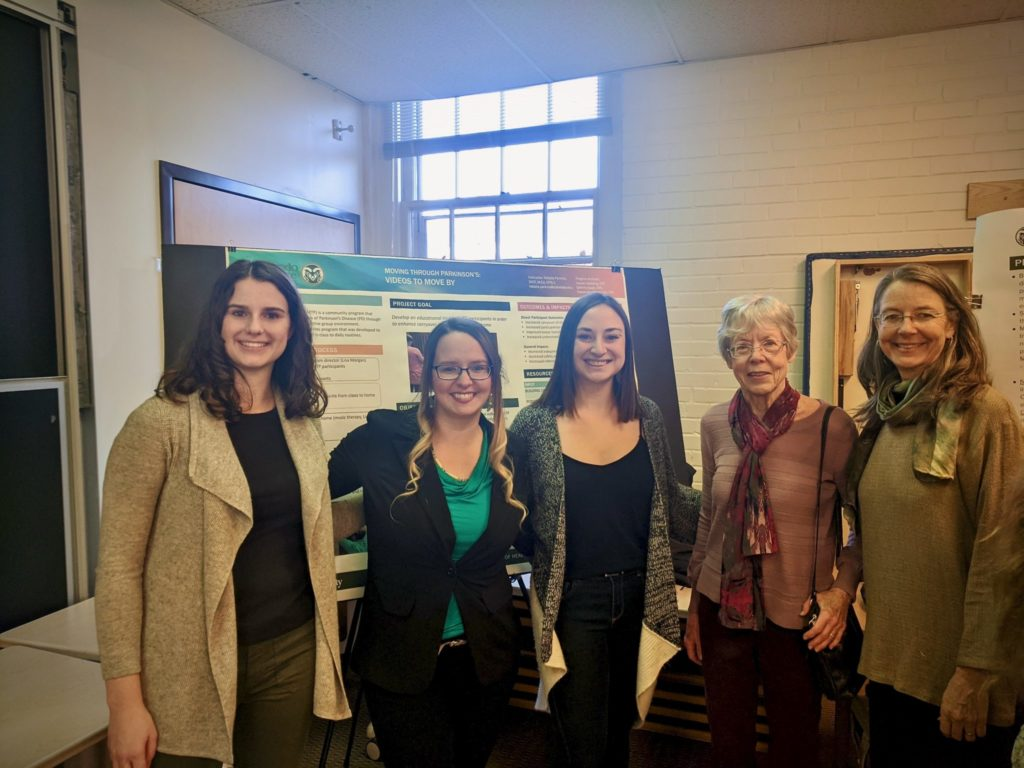 Five women smiling in front of their research poster about combining dance and parkinsons treatment
