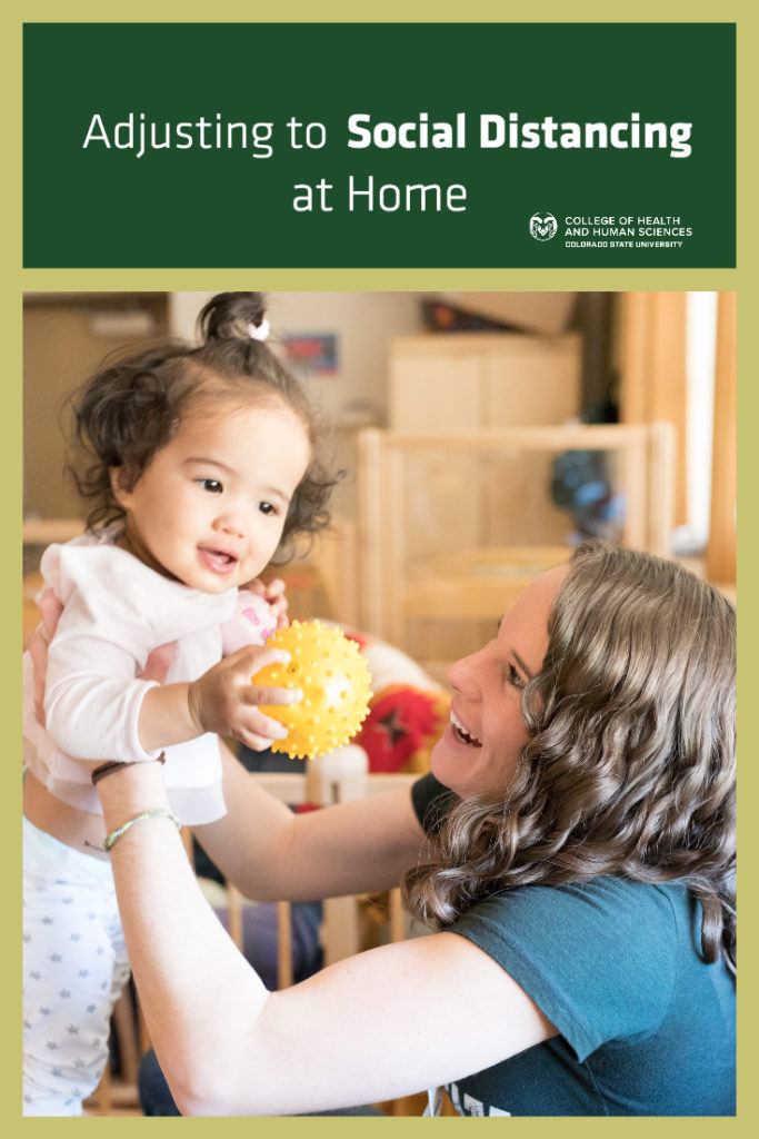 """""""Adjusting to social distancing at home"""" picture with a preschool teacher holding up a toddler"""