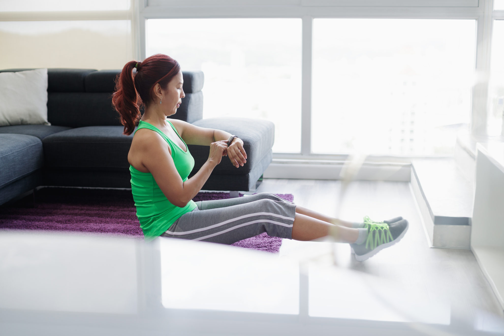 woman in her 40s exercising in her living room