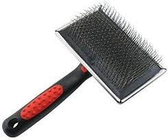 grooming tool with pin-style brush end