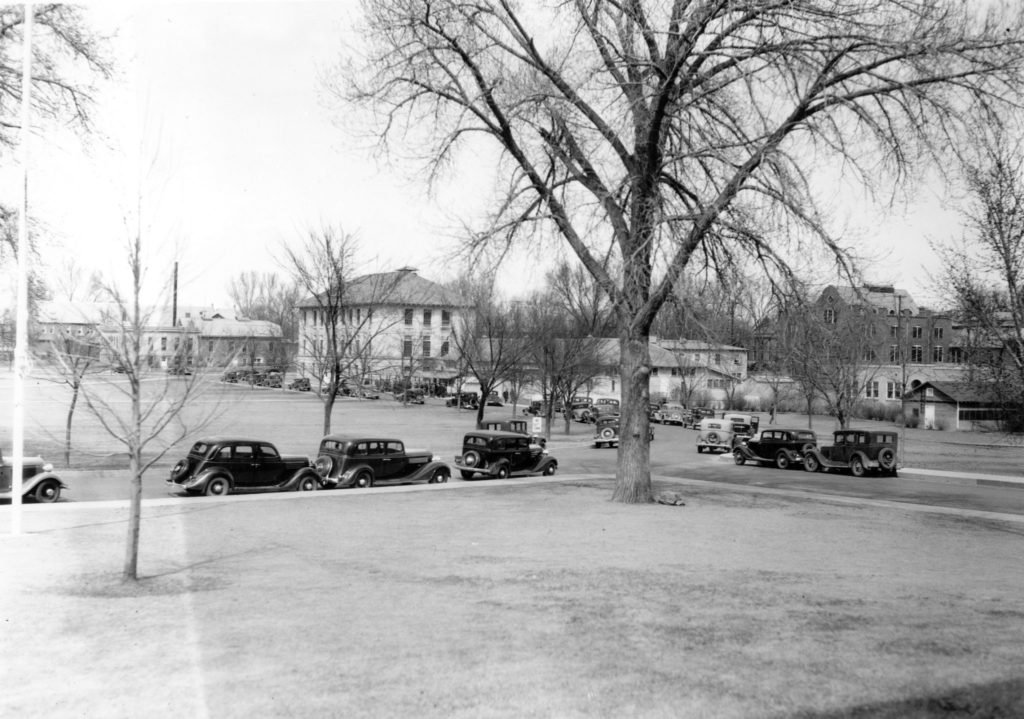 In the 1930s cars driving across the oval with OT building in the background