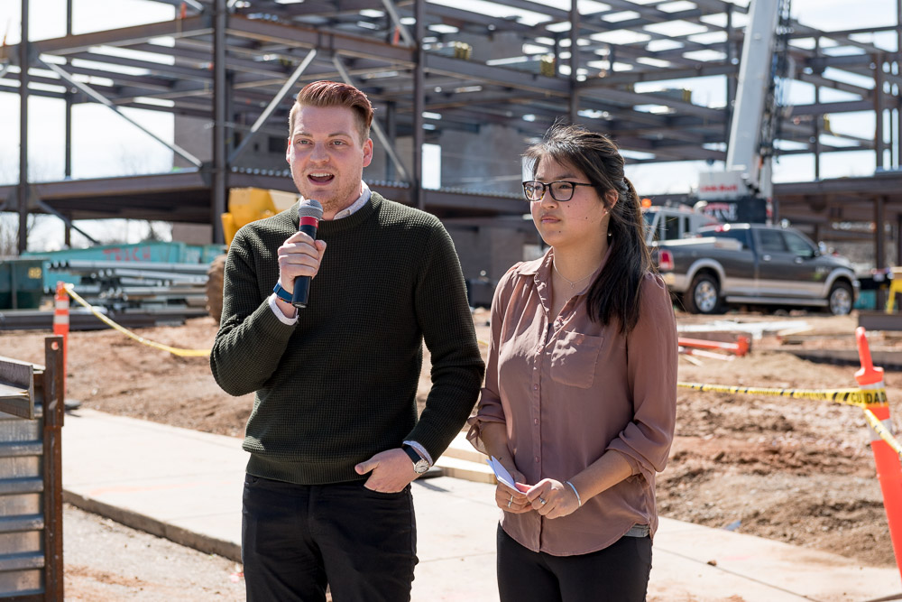 Nicholas Hahn speaking at the construction site of the Nancy Richardson Design Center at the final beam raising ceremony