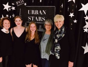 """Isabelle Clement standing with fellow students and faculty members at the """"Urban Stars"""" fashion show"""