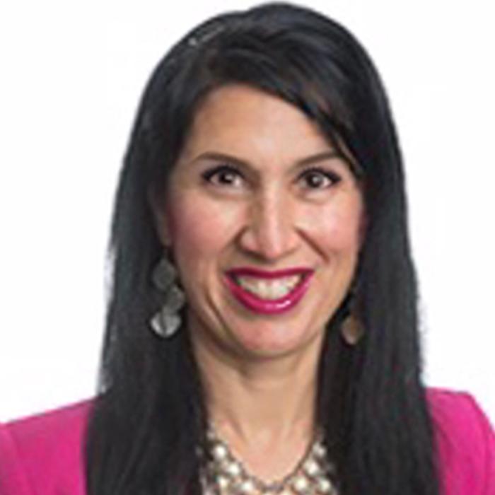 Dr. Antonette Aragón in a pink sweater.