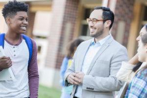 Teacher talks with students