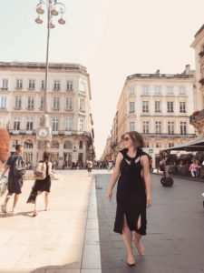 Isabelle Clement walking the streets of France during her time abroad