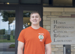 Taylor Ewell standing outside the Human Performance Clinical Research Laboratory