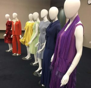 Classroom demonstration using rainbow colored outfits including the purple dress