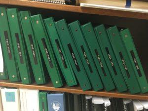 Green Binders on Avenir Shelf