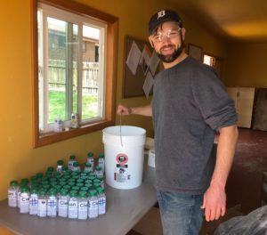 lisa smith's partner making sanitizer in their backyard workshop