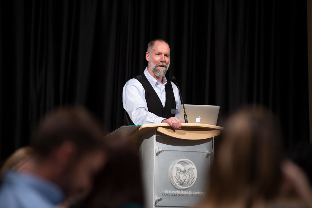 Matt Hickey speaking at the College of Health and Human Sciences Research Day in March.