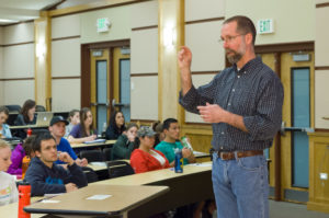 Matt Hickey teaches a health and exercise science class in 2012.
