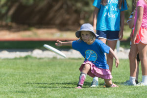 Young camper throwing a Frisbee