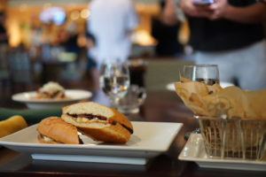 sandwich and fries on table for tasting and serving practice