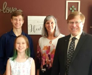 Brett Berg with his wife, son and daughter