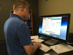 Brett at a computer conducting research