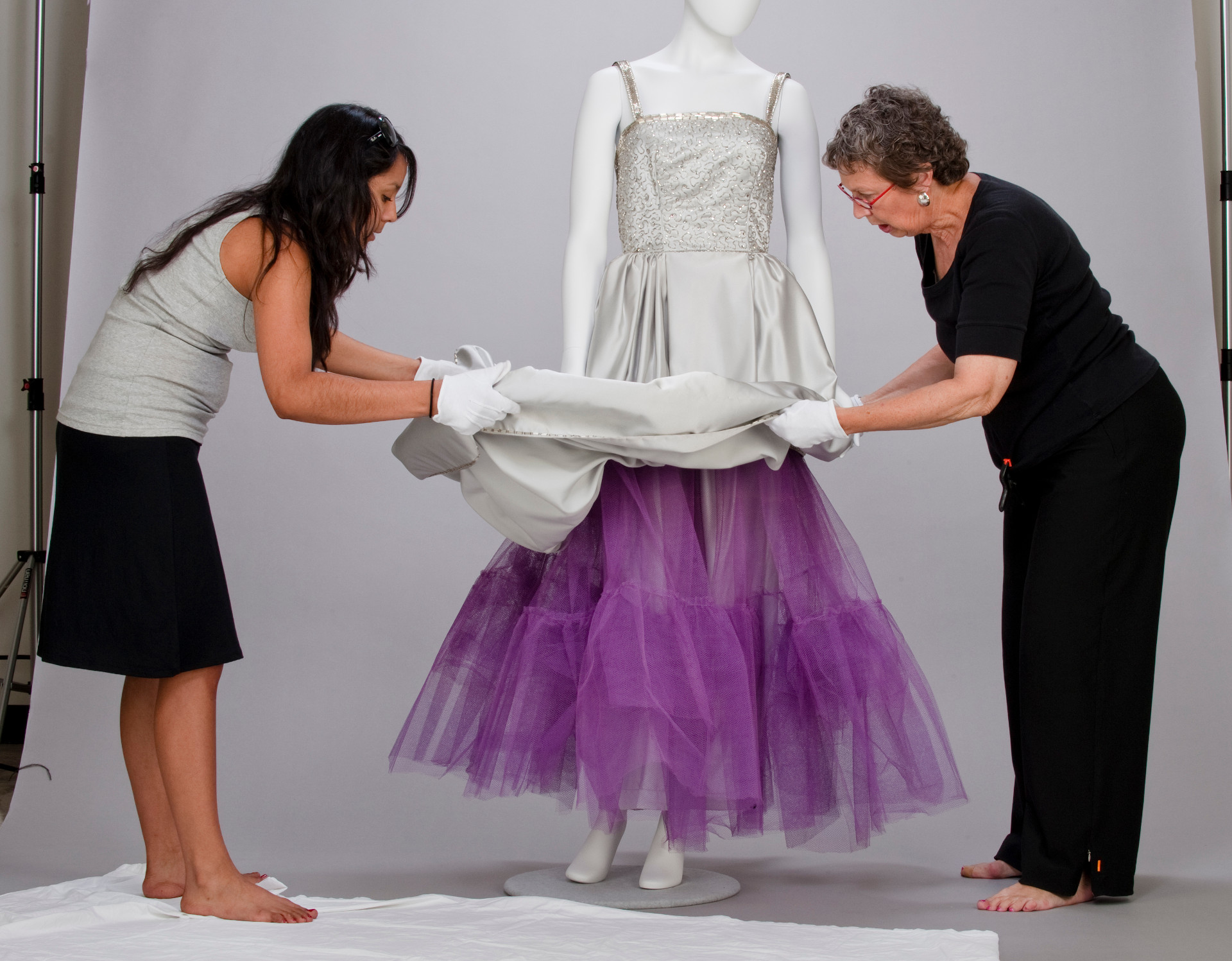Linda Carlson arranging dress