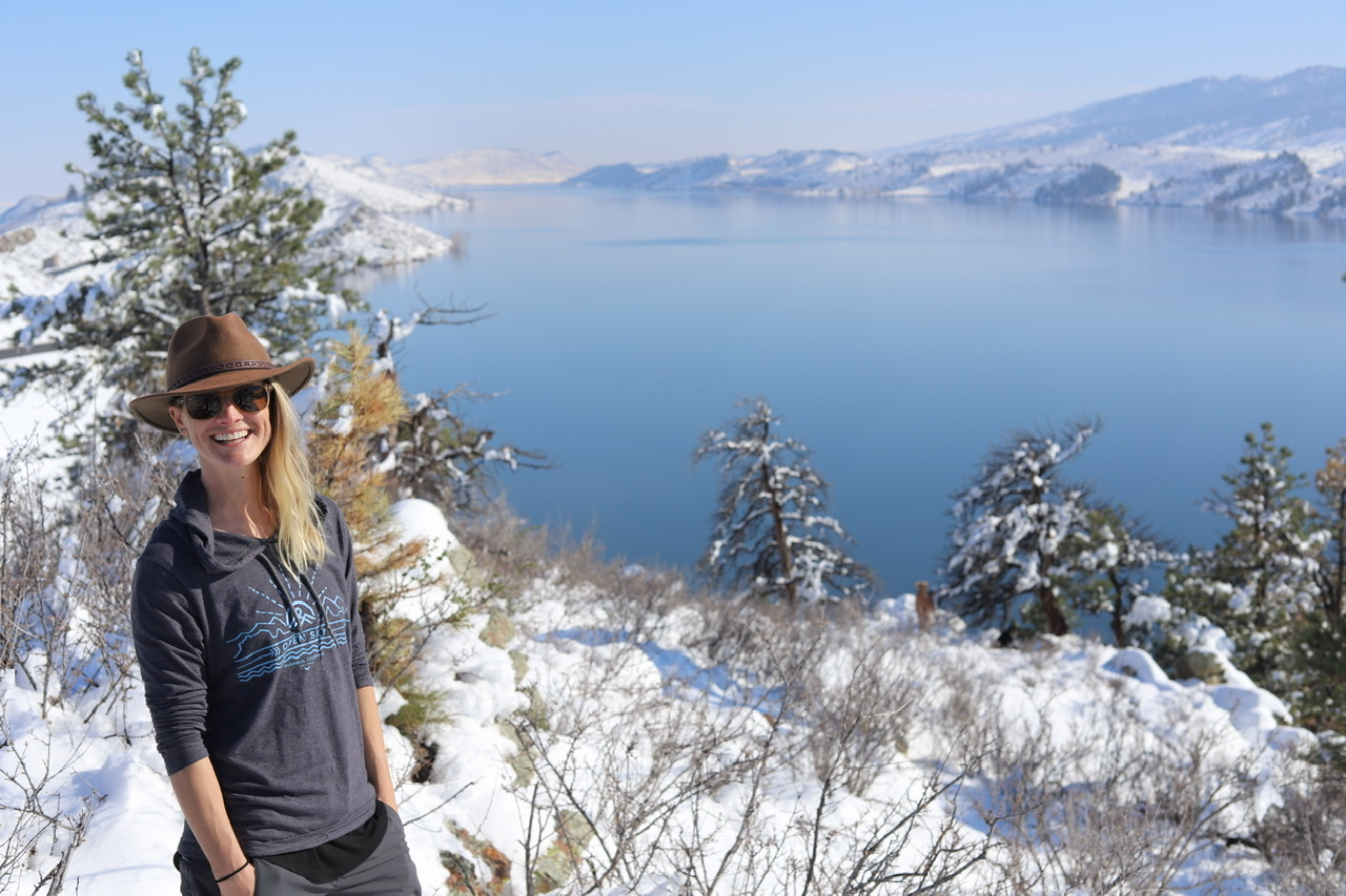msw student becca reymann smiling in front of a mountain lake