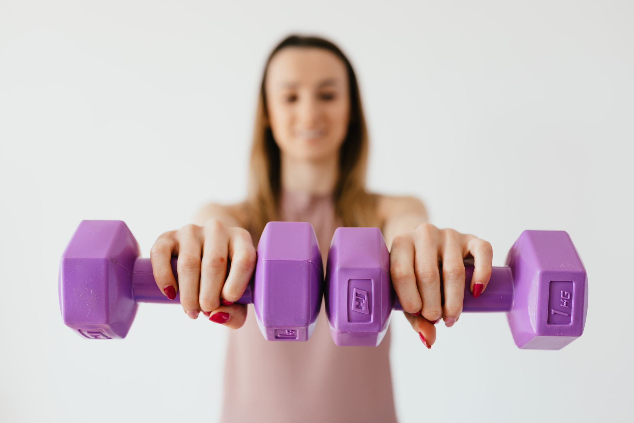 Woman holding barbells