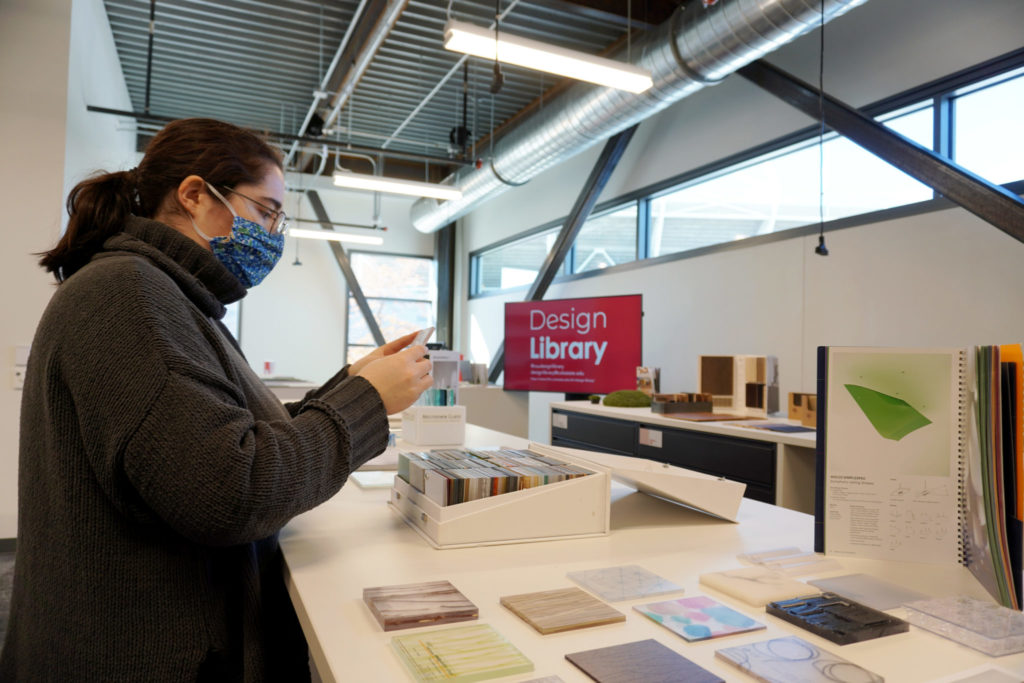 Student looking at sample in the Design Library