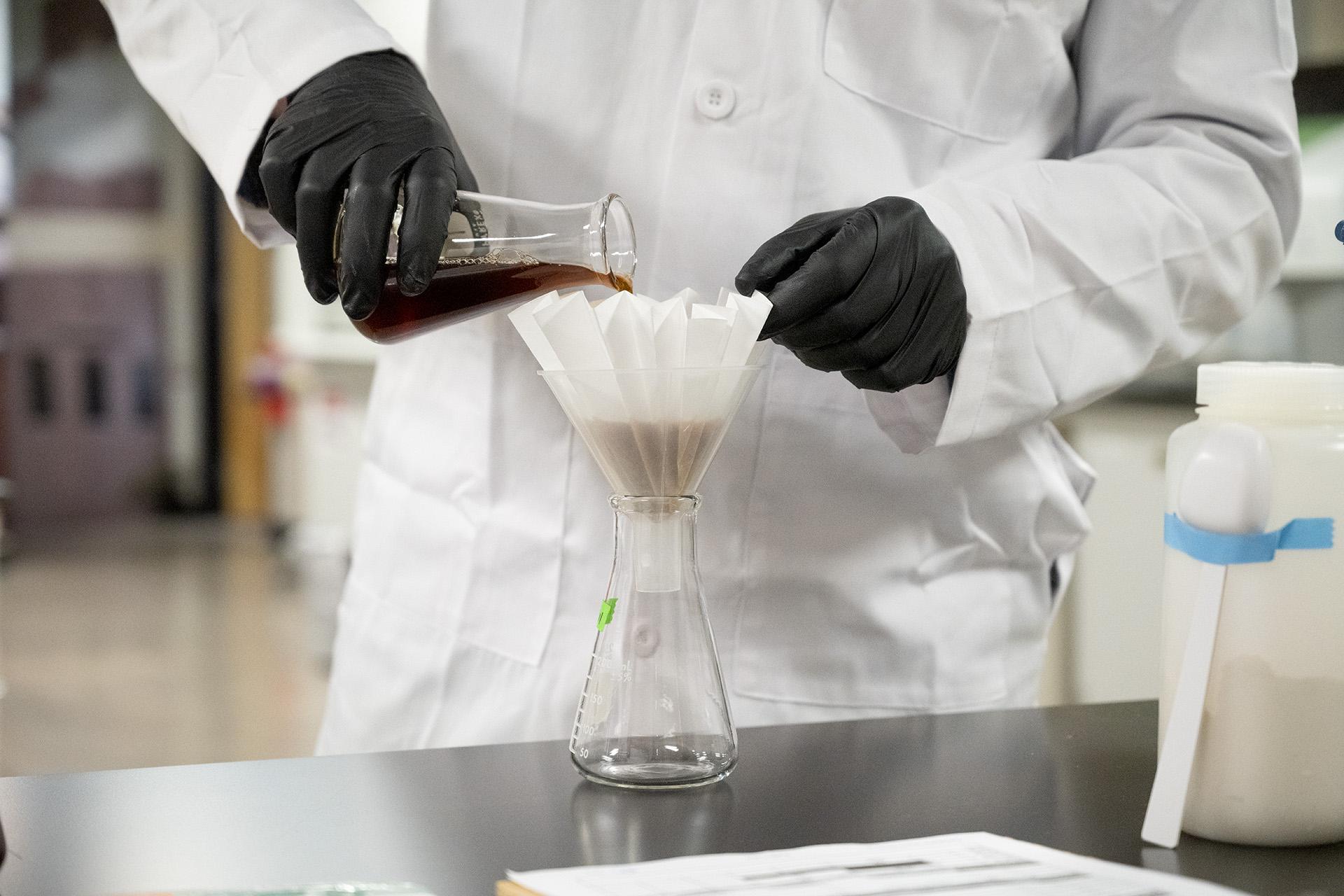 Student in malt testing lab
