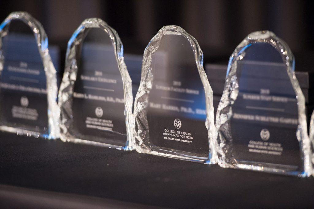 Row of glass award trophies