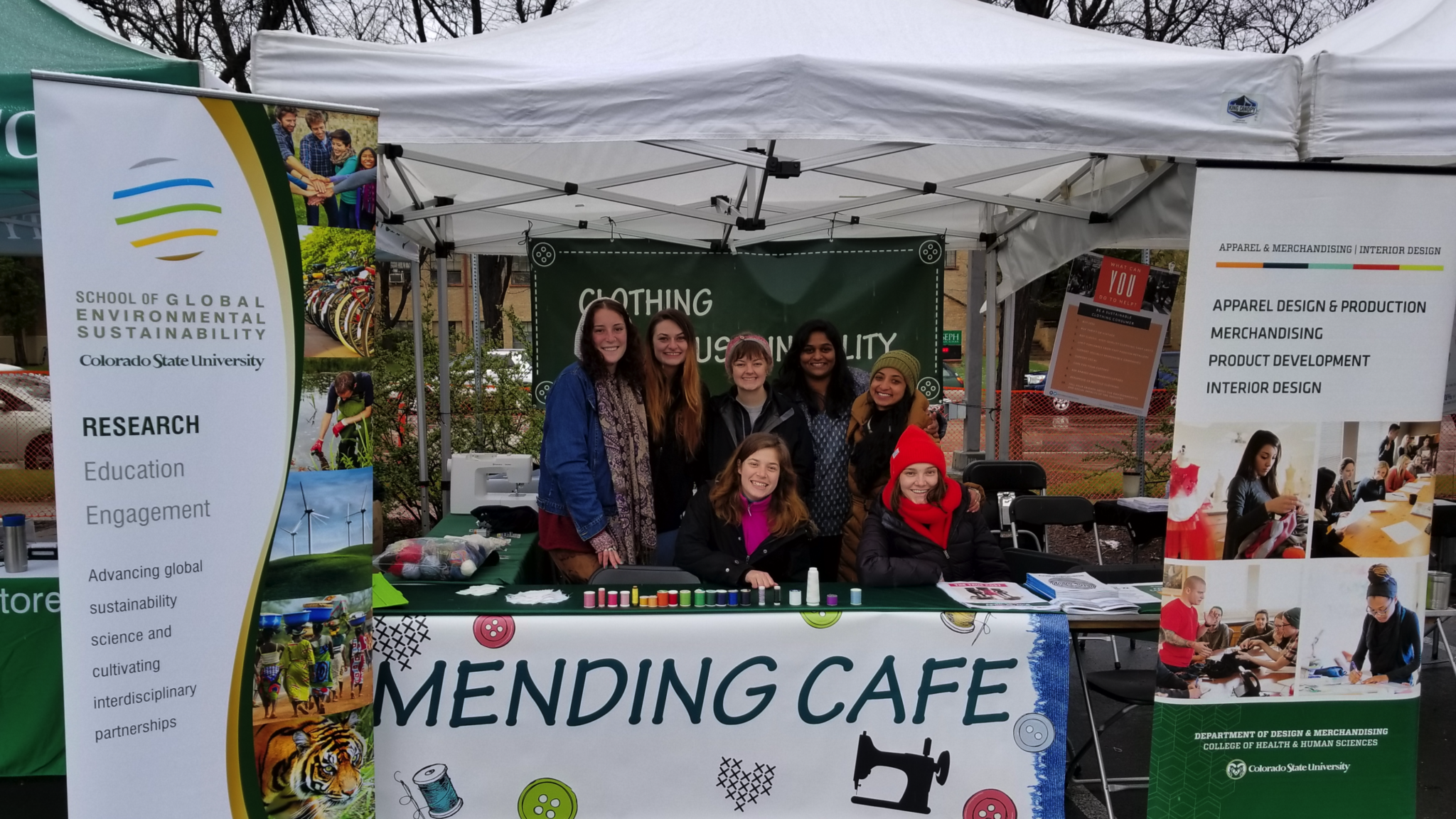 Design and Merchandising associate professor Sonali Diddi (third from right) joins students in hosting a Mending Café community clothing repair event in Fort Collins, April 21, 2018.]