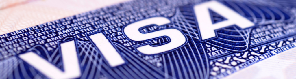 stock photo illustration for immigration themed story showing a closeup photo of a visa document