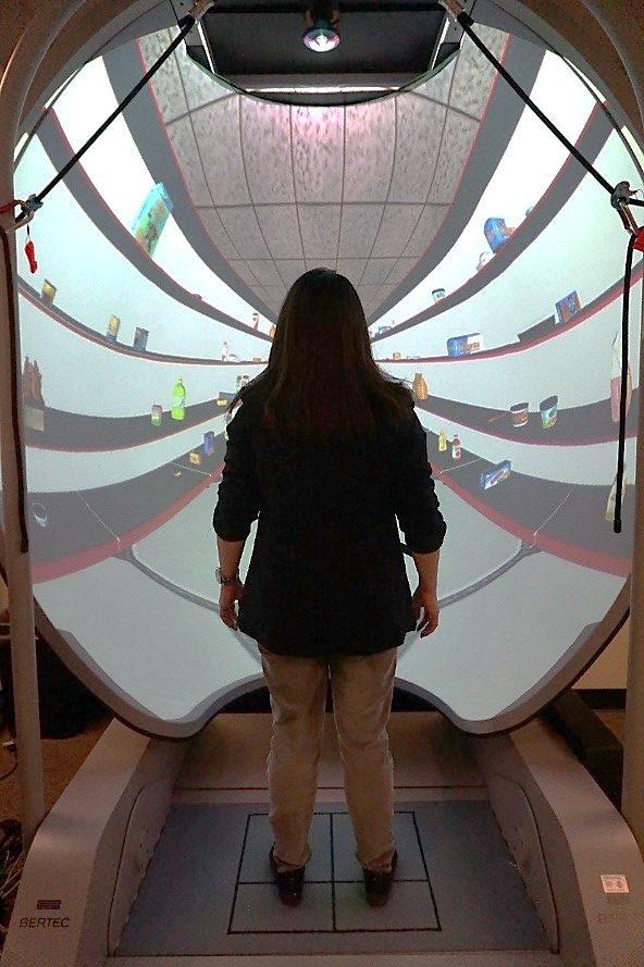 Participant standing immersive virtual environment dome