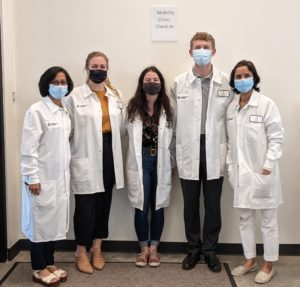 Group of faculty and students in lab coats