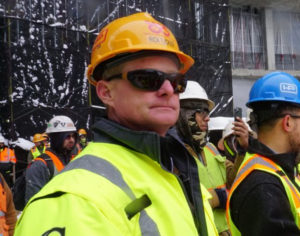 Rick Tucker on jobsite in hardhat