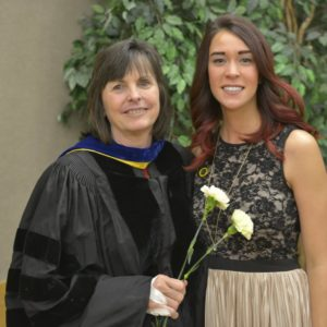 brenda miles with a bsw student at graduation