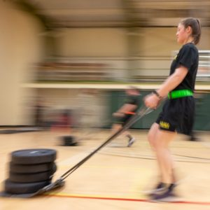 An ROTC student pulling weights