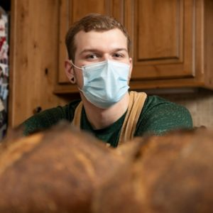 Noah Bowman with bread loaves