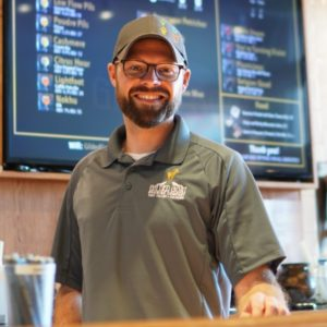 Charlie Hoxmeier behind the bar at the Gilded Goat