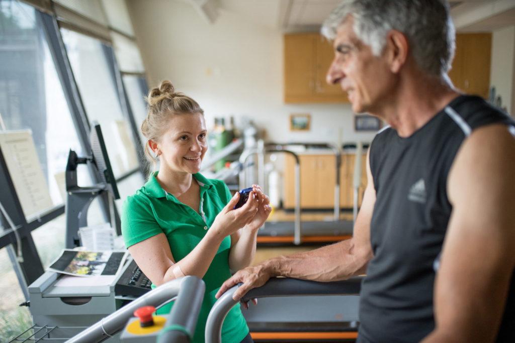 Dr. Burzynska working with older man on healthy aging.