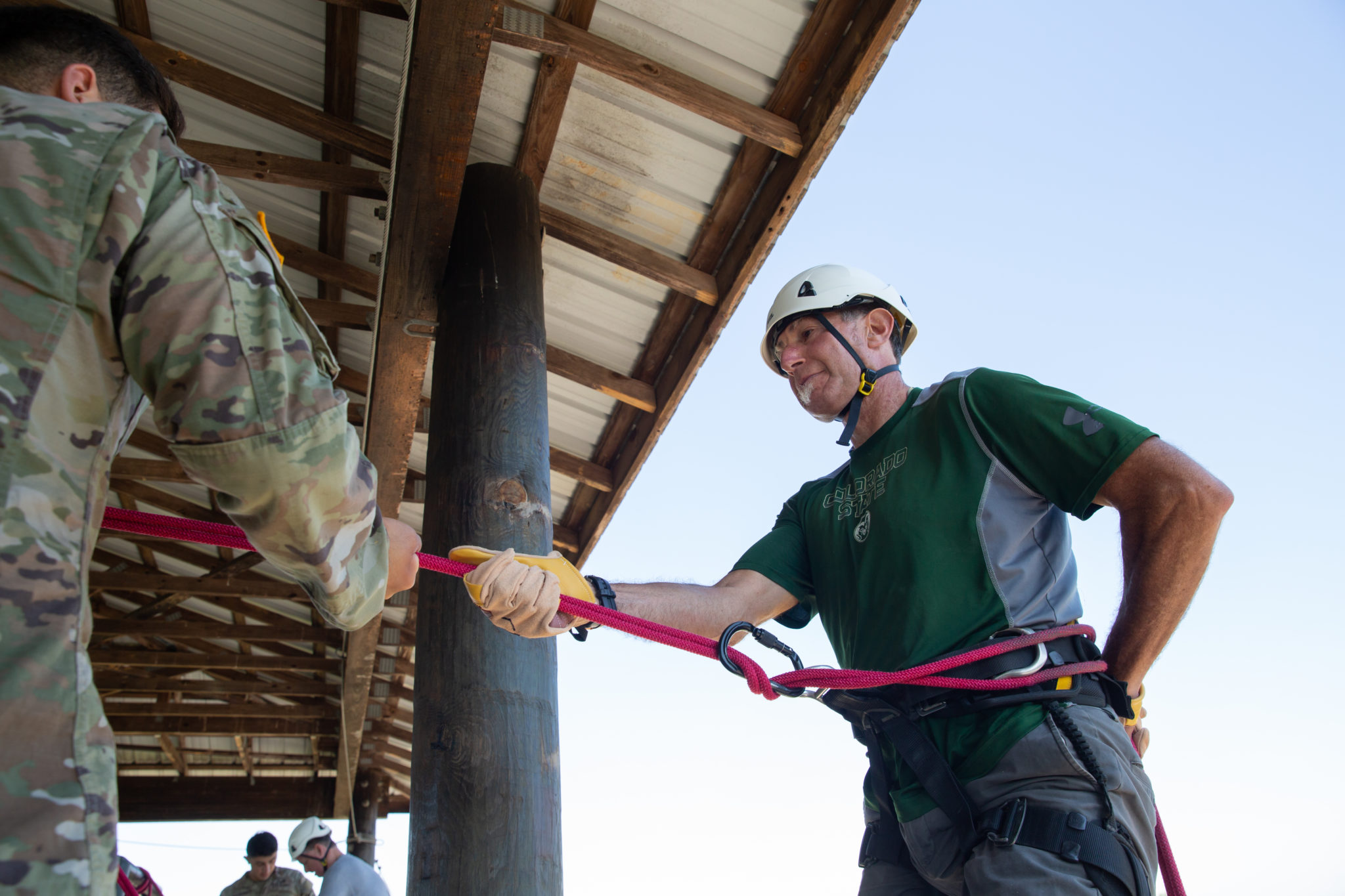 Barry Braun prepares to rappel off a 60-foot tower