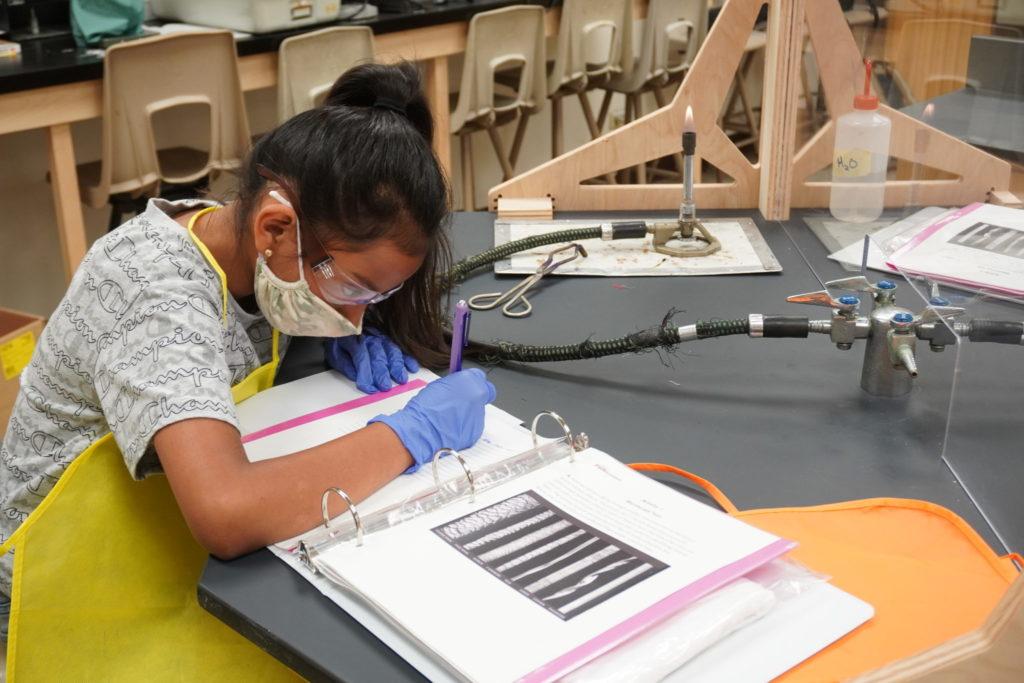 Girl writing in a binder