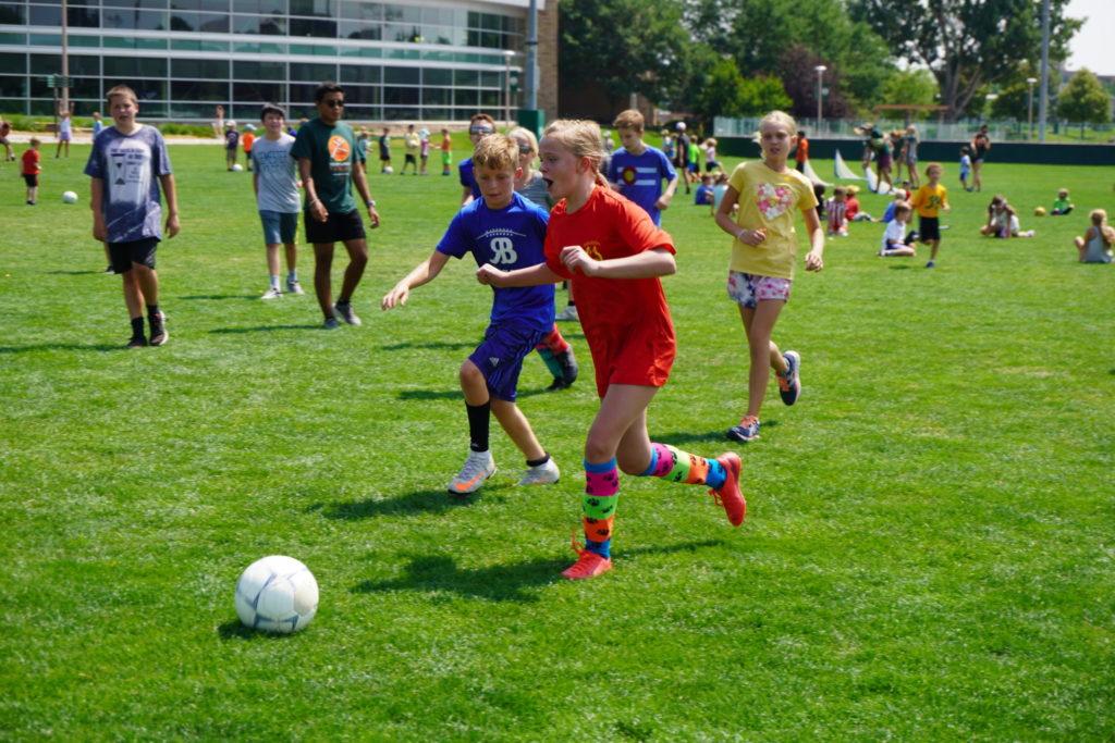 Children play soccer in CSU's IM Fields.