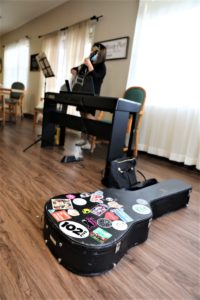 Guitar case in focus with Nagata tuning guitar in background